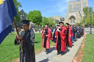 Cross Campus procession begins